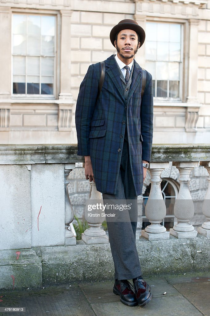 Milliner Latouche wears Doctor Martin shoes, Ralph Lauren trousers, Debenhams jacket, Lacoste shirt and vintage tie on day 5 of London Collections: Women on February 18, 2014 in London, England.