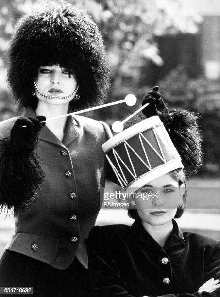 Milliner Philip Somerville known for his whimsical creations has model Laura who is wearing a busbyinspired headdress with a 220 price tag drumming...