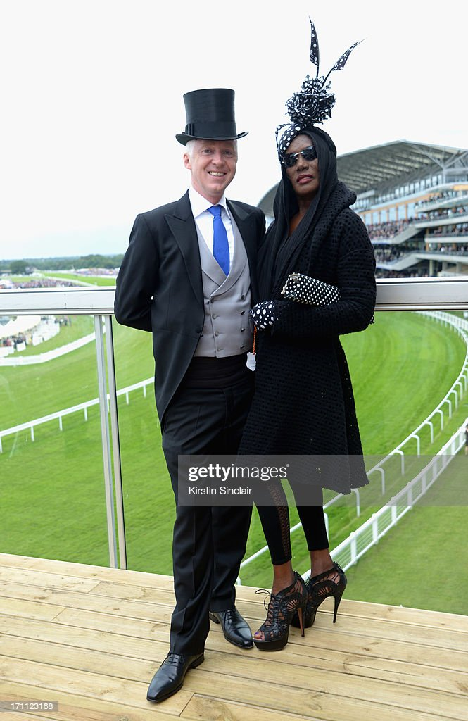 Milliner <a gi-track='captionPersonalityLinkClicked' href=/galleries/search?phrase=Philip+Treacy+-+Fashion+Designer&family=editorial&specificpeople=12819932 ng-click='$event.stopPropagation()'>Philip Treacy</a> and <a gi-track='captionPersonalityLinkClicked' href=/galleries/search?phrase=Grace+Jones+-+Performer&family=editorial&specificpeople=156417 ng-click='$event.stopPropagation()'>Grace Jones</a> attend day five of Royal Ascot at Ascot Racecourse on June 22, 2013 in Ascot, England.