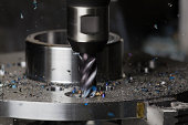 A hole is milled in a flange on a CNC machining center using a carbide endmill