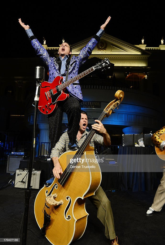 <a gi-track='captionPersonalityLinkClicked' href=/galleries/search?phrase=Million+Dollar+Quartet&family=editorial&specificpeople=5578231 ng-click='$event.stopPropagation()'>Million Dollar Quartet</a> from Harrah's Las Vegas performs at the closing night party for IPW 2013 at the Garden for the Gods pool at Caesars Palace on June 12, 2013 in Las Vegas, Nevada.