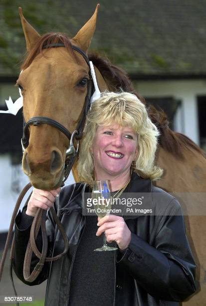 1 Million Lottery winner Kathy Young a groom at Nicky Henderson's racing stables near Lambourn Berkshire celebrates her Christmas Eve win with Madge...