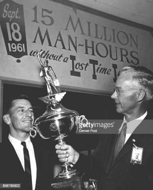 Million Safe Hours Herbert D Doan left executive Vice President of the Dow Chemical Co Midland Mich presents the Atomic Energy commission's Trophy of...