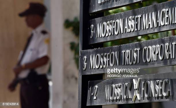 A private security guard stands outside the building where Panamabased Mossack Fonseca law firm is based in Panama City on April 5 2016 A massive...