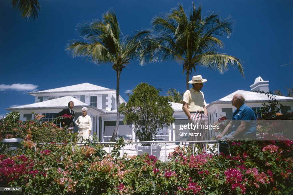 Millionaire Edward Plunket Taylor (right) at his house in Lyford Cay, New Providence Island, with his son-in-law Alan Edwards and visitors Mrs Henry Mercer and her son Douglas, April 1974.