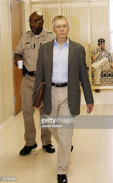 Millionaire murder defendant Robert Durst is escorted into State District Judge Susan Criss November 10 2003 at the Galveston County Courthouse in...