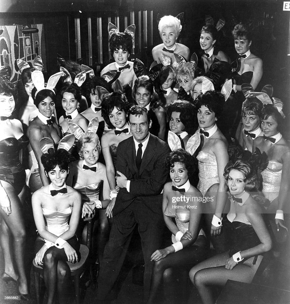 Millionaire publisher of Playboy magazine Hugh Hefner poses with a bevy of bunny girls at one of America's chain of Playboy clubs