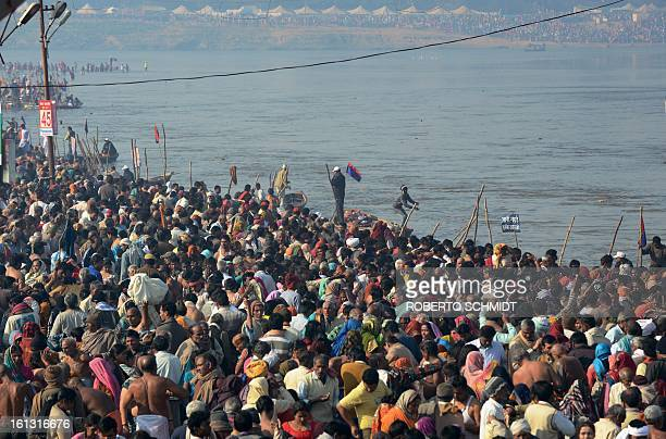 Millions of devotees congregate at the Sangam or confluence of the Yamuna Ganges and mythical Sarawati rivers on the auspicious day of 'Mauni...
