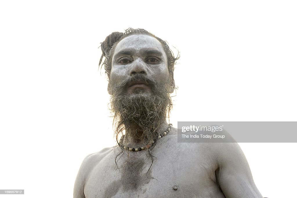 Millions of devout Hindus, led by naked ascetics with ash smeared on their bodies, plunged into the frigid waters of the Ganga on Monday, in a ritual they believe can wash away their sins.
