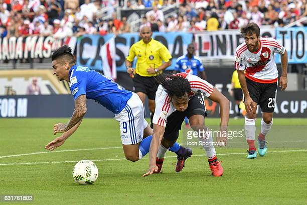 Millonarios forward Christian Daniel Arango Duque and River Plate defender Arturo Mina collide during the first half of a Florida Cup quarterfinal...