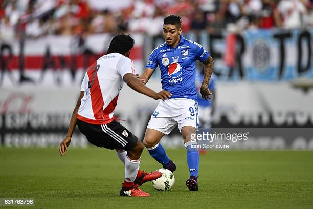 Millonarios forward Christian Daniel Arango Duque is challenged by River Plate defender Arturo Mina during the first half of a Florida Cup...