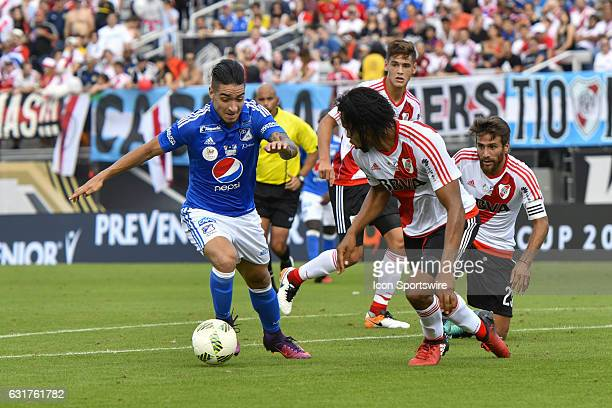 Millonarios forward Christian Daniel Arango Duque takes on River Plate defender Arturo Mina during the first half of a Florida Cup quarterfinal match...
