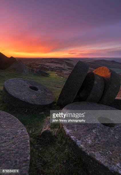 Millstones of the Peak District National park at sunrise in Derbyshire, UK