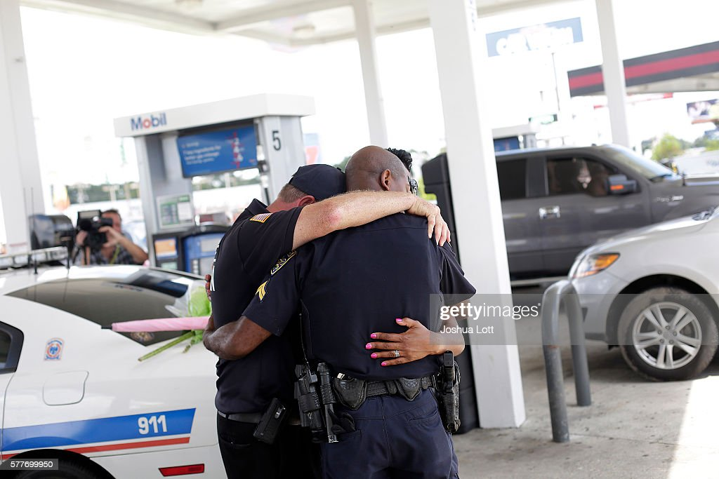 Millville New Jersey police chaplain Bob Ossler prays with Baton Rouge Police Department Corporal Trina Dorsey and her brother Corporal Joseph Keller...