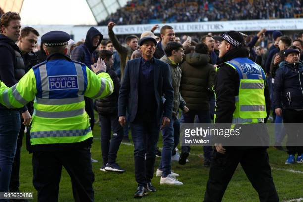 Millwall fan attempts to confront the Leicester City fans after The Emirates FA Cup Fifth Round match between Millwall and Leicester City at The Den...