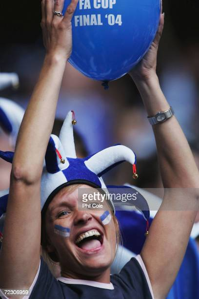 Millwall fan cheers her team on during the 123rd FA Cup Final between Manchester United and Millwall at The Millennium Stadium on May 22 2004 in...