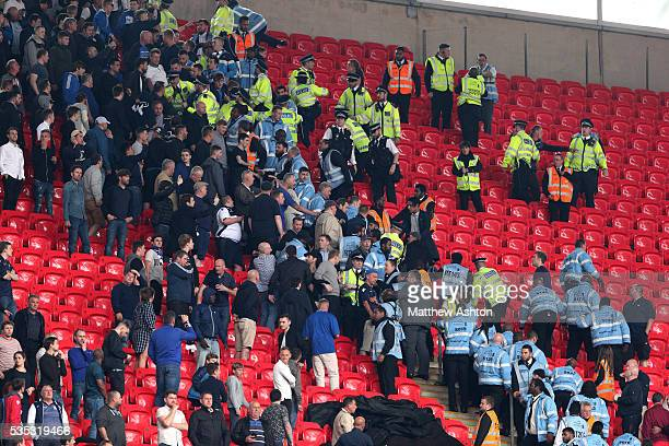 Millwall fans cause a disturbance in the segregated area next to the Barnsley fans during the Sky Bet League One Play Off Final between Barnsley and...