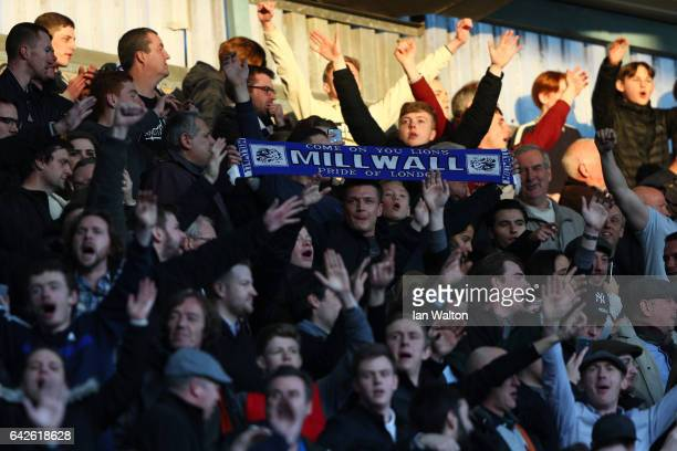 Millwall fans celebrate during The Emirates FA Cup Fifth Round match between Millwall and Leicester City at The Den on February 18 2017 in London...