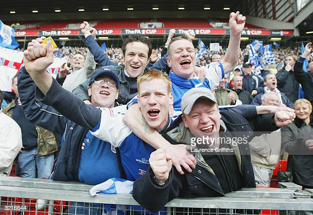 Millwall fans celebrate their win after the FA Cup Semi Final match between Sunderland and Millwall at Old Trafford on April 4 2004 in Manchester...