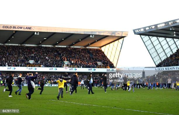 Millwall fans invade the pitch after The Emirates FA Cup Fifth Round match between Millwall and Leicester City at The Den on February 18 2017 in...