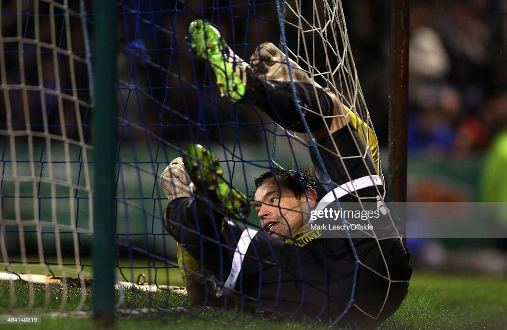 Millwall goalkeeper <a gi-track='captionPersonalityLinkClicked' href=/galleries/search?phrase=David+Forde+-+Soccer+Goalkeeper&family=editorial&specificpeople=1816778 ng-click='$event.stopPropagation()'>David Forde</a> as he gets trapped in the back of the net during the FA Cup Third Round match between Southend and Millwall at Roots Hall on January 4, 2014 in Southend, England.