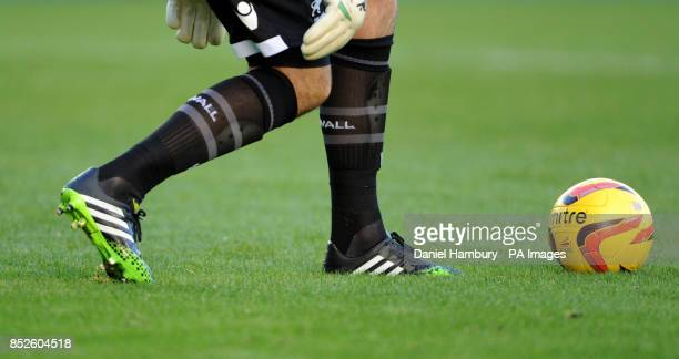 Millwall goalkeeper David Forde kicks the official matchball of the Football League the Mitre Delta V12 Fluo