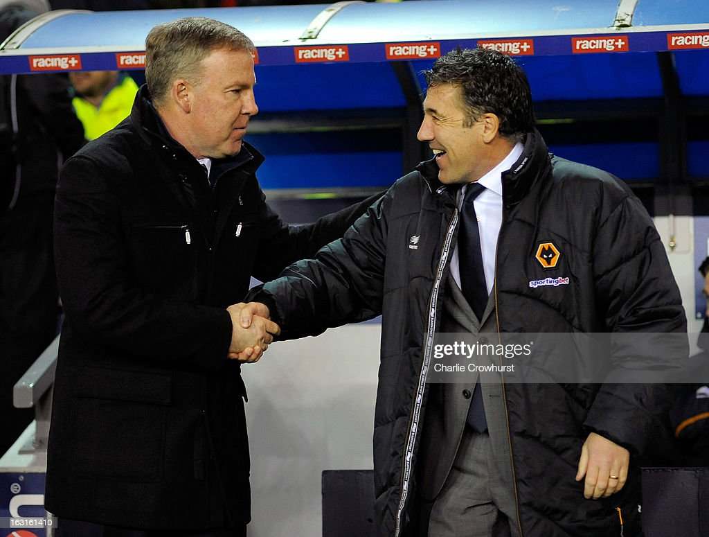 Millwall manager Kenny Jackett (L) shakes hands with Wolves manager Dean Saunders during the npower Championship match between Millwall and Wolverhampton Wanderers at The Den on March 05, 2013 in London, England,
