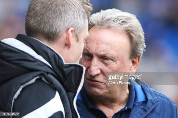 Millwall manager Neil Harris meets Cardiff City manager Neil Warnock prior to kick off of the Sky Bet Championship match between Cardiff City and...