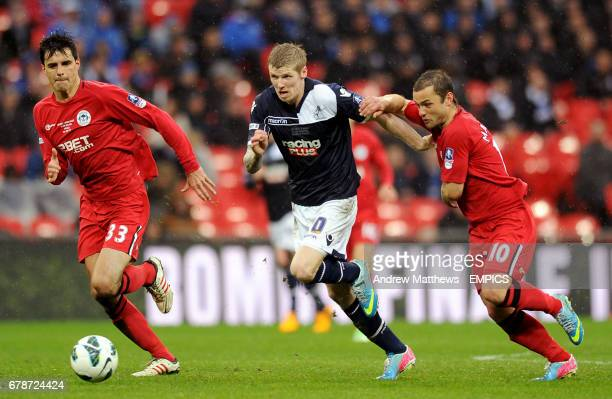Millwall's Andy Keogh in action with Wigan Athletic's Shaun Maloney and Paul Scharner