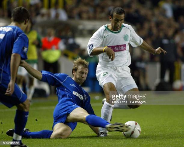 Millwall's David Livermore and Ferencvaros' Dragan Vukmir tussle for the ball during the UEFA Cup First Round First Leg tie at the New Den south east...