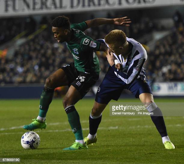 MillwallÕs David Worrall and Scunthorpe UnitedÕs Ivan Toney during the Sky Bet League One Playoff first leg match at The New Den London