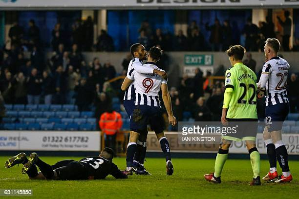 Millwall's Englishborn Jamaican defender Shaun Cummings celebrates with Millwall's English striker Lee Gregory after scoring their second goal during...