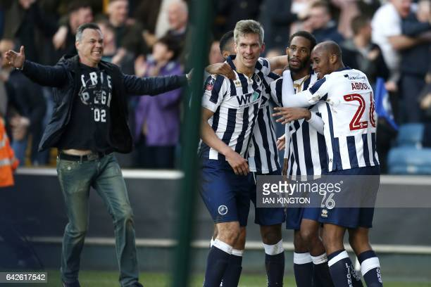 Millwall's Englishborn Jamaican defender Shaun Cummings celebrates with teammates after scoring the only goal of the English FA Cup fifth round...