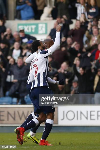 Millwall's Englishborn Jamaican defender Shaun Cummings celebrates after scoring the only goal of the English FA Cup fifth round football match...