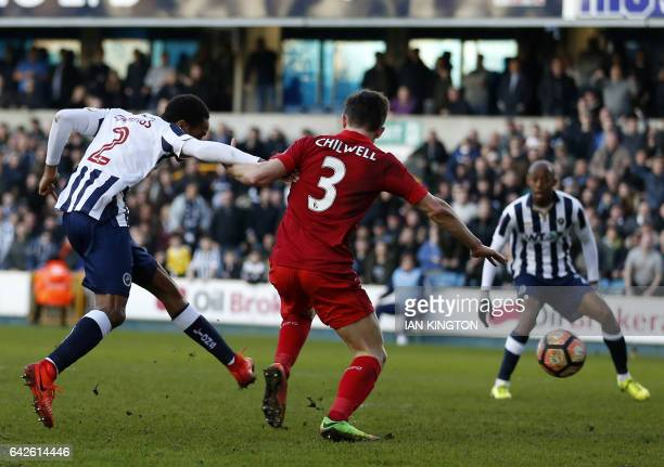 Millwall's Englishborn Jamaican defender Shaun Cummings shoots to score the opening goal of the English FA Cup fifth round football match between...