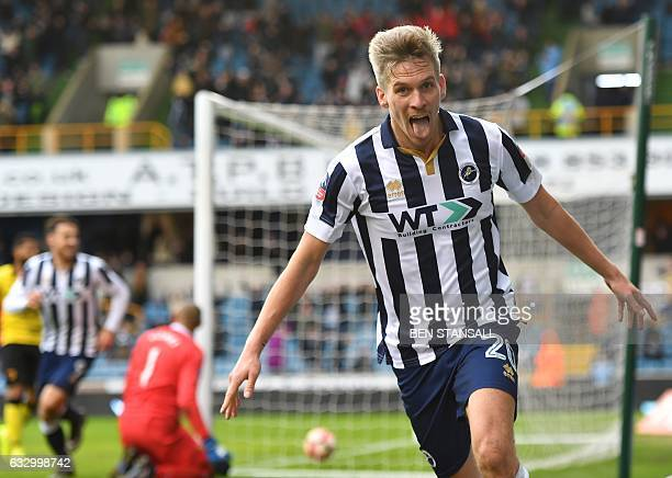Millwall's Englishborn Welsh striker Steve Morison celebrates after scoring the opening goal of the English FA Cup fourth round football match...