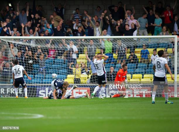 Millwall's George Saville scores the opening goal leaving Bolton Wanderers' goalkeeper Mark Howard dejected during the Sky Bet Championship match...