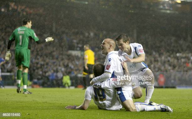Millwall's goalkeeper David Forde reacts as Leeds United's Ben Parker Andy Robinson and Jonathan Howson celebrtae after team mate Luciano Becchio...