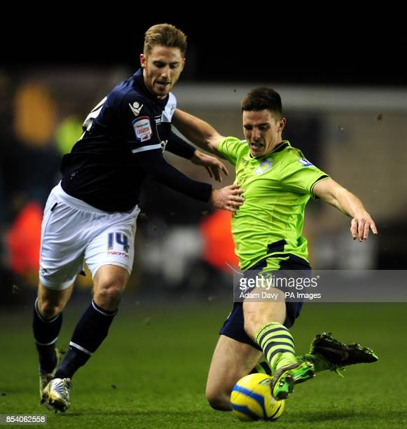 Millwall's James Henry and Aston Villa's Ciaran Clark battle for the ball