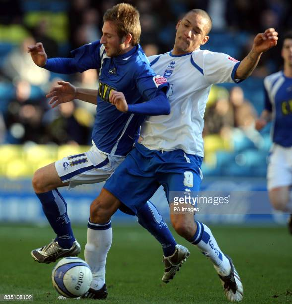 Millwall's James Henry and Brighton Hove Albion's Jason Jarrett battle for the ball during the CocaCola League One match at The Den London