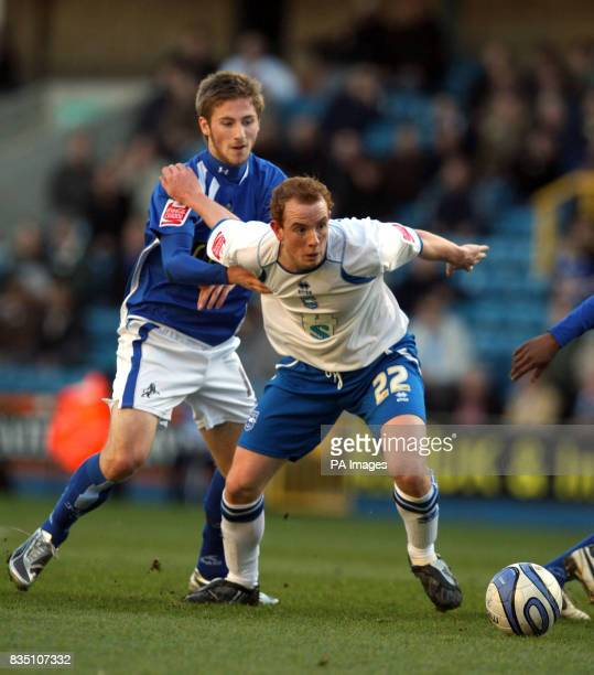 Millwall's James Henry and Brighton Hove Albion's Tommy Fraser battle for the ball during the CocaCola League One match at The Den London