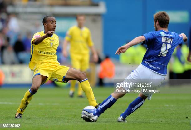 Millwall's James Henry and Leeds' Fabian Delph battle for the ball match at The Den London