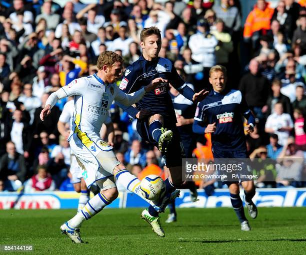 Millwall's James Henry and Leeds United's Paul Green battle for the ball