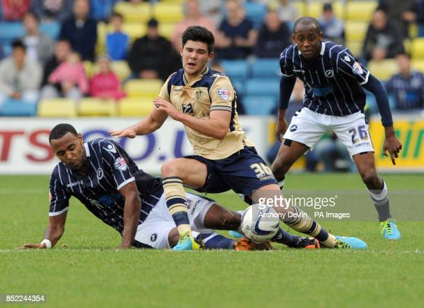 Millwall's Jermaine Easter and Leeds Alex Mowatt Austin battle for the ball during the Sky Bet Championship match at The New Den London