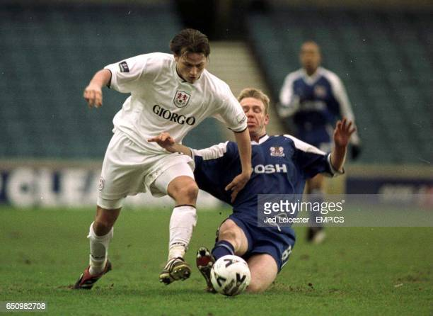 Millwall's Marc Bircham is tackled by Peterborough United's David Oldfield