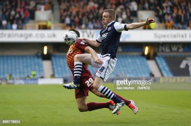 Millwall's Shane Ferguson and Bradford City's Tony McMahon battle for the ball