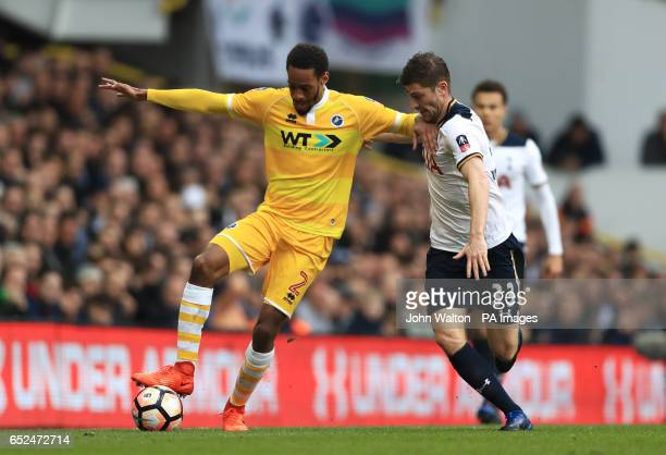 Millwall's Shaun Cummings and Tottenham Hotspur's Ben Davies battle for the ball during the Emirates FA Cup Quarter Final match at White Hart Lane...