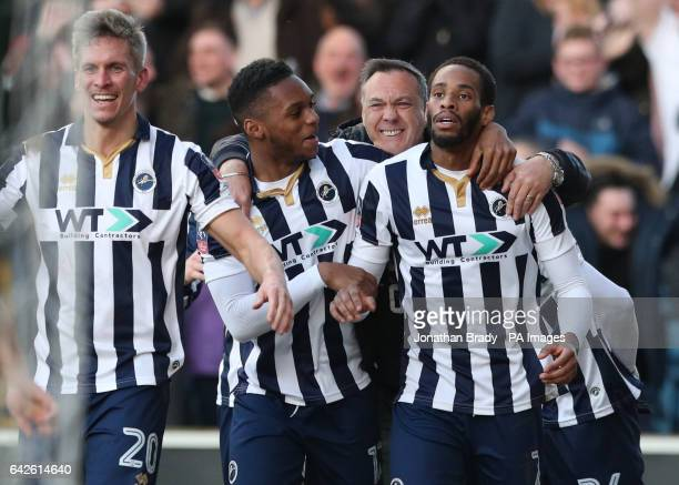 Millwall's Shaun Cummings celebrates scoring his sides opening goal during the Emirates FA Cup Fifth Round match at The Den Millwall