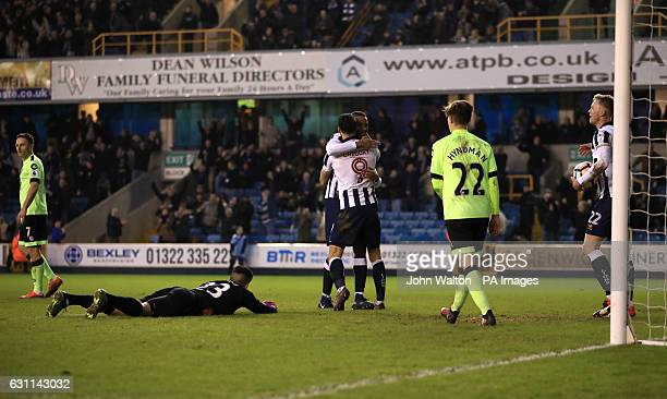 Millwall's Shaun Cummings celebrates scoring his side's second goal of the game during the Emirates FA Cup Third Round match at The Den London