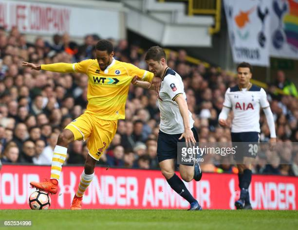 Millwall's Shaun Cummings holds of Tottenham Hotspur's Ben Davies during the The Emirates FA Cup Sixth Round match between Tottenham Hotspur and...